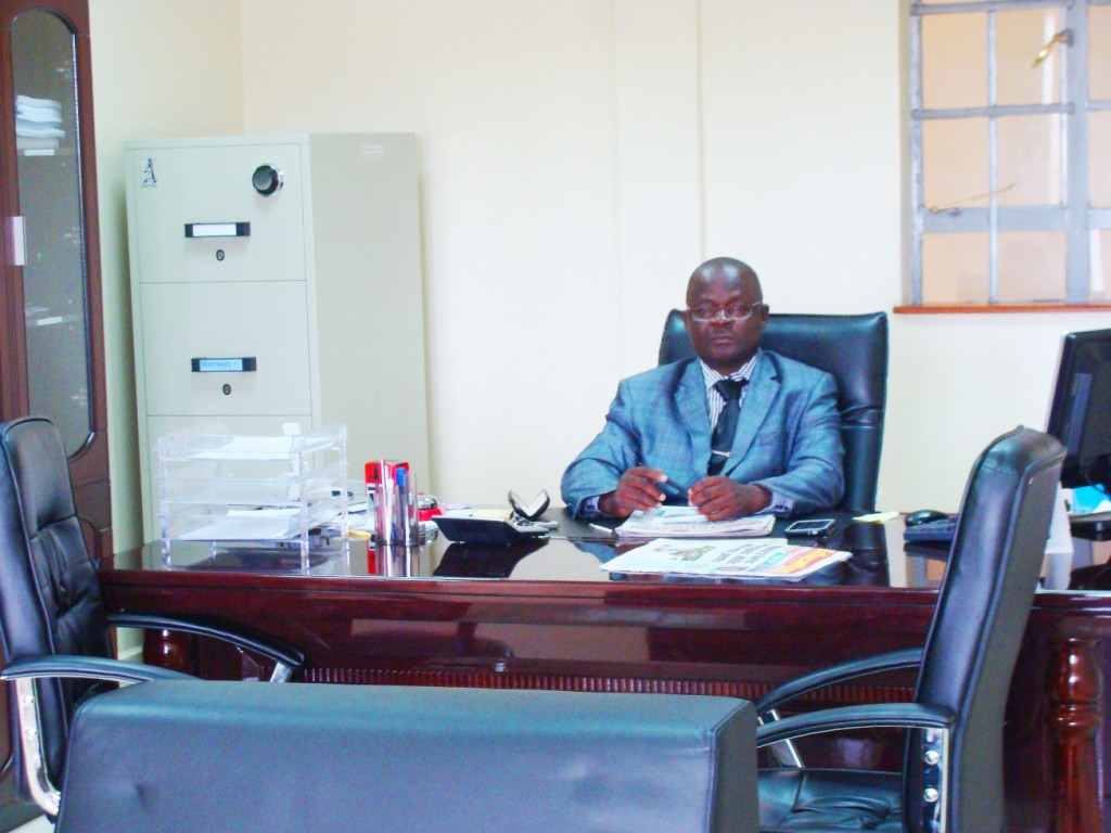 The Principal - Mr Peter Omondi, in his office
